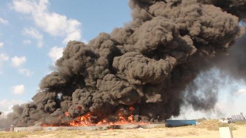 fire industrial firefighters battle blaze in packa Footage
