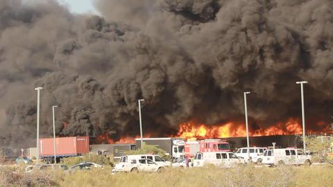 firefighters battle blaze in packaging factory ind Stock Video Footage