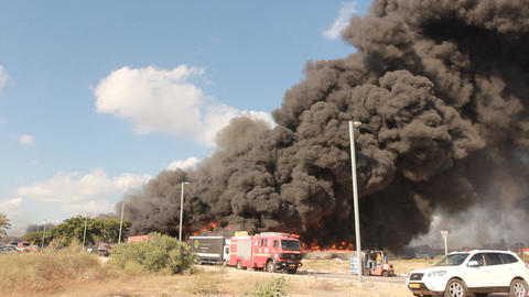 firefighters battle blaze in packaging factory ind Stock Video Footage