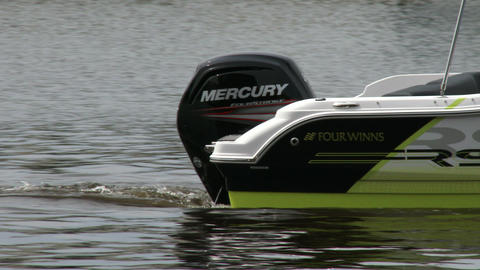Outboard engine on small boat Live Action