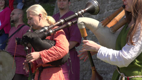 The musician plays the bagpipes. 4K Stock Video Footage