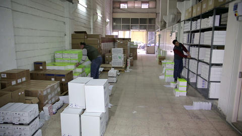 IZMIR, TURKEY - JANUARY 2013: Men working in stora Footage