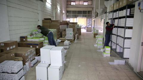 IZMIR, TURKEY - JANUARY 2013: Men working in stora Stock Video Footage