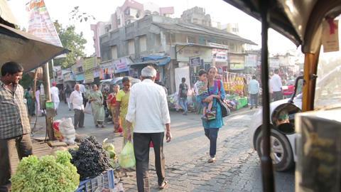 MUMBAI, INDIA - MARCH 2013: Busy street market sce Stock Video Footage