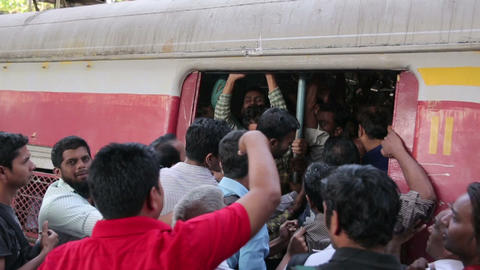MUMBAI, INDIA - MARCH 2013: People getting on a cr Stock Video Footage