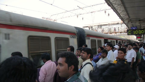 MUMBAI, INDIA - MARCH 2013: People at crowded trai Stock Video Footage