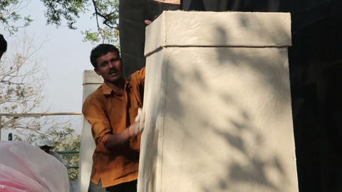 MUMBAI, INDIA - MARCH 2013: Two Indian masons at w Footage