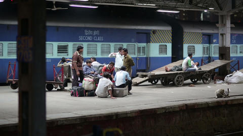 MUMBAI, INDIA - MARCH 2013: People waiting on rail Footage