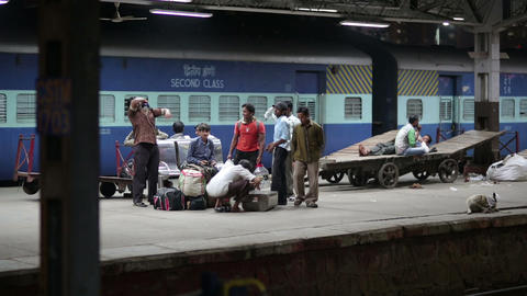 MUMBAI, INDIA - MARCH 2013: People waiting on rail Stock Video Footage