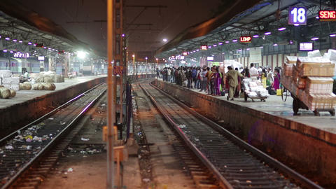 MUMBAI, INDIA - MARCH 2013: People waiting on rail Stock Video Footage