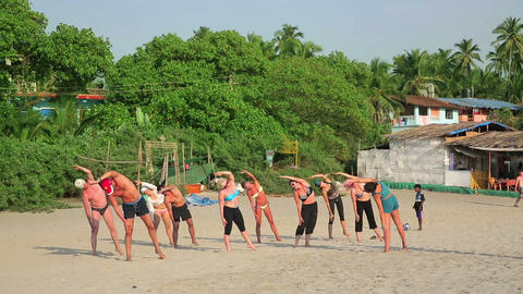 GOA, INDIA - MARCH 2013: People practicing yoga on Stock Video Footage