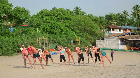 GOA, INDIA - MARCH 2013: People Practicing Yoga On stock footage