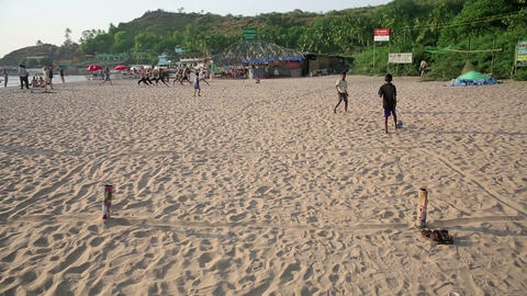 GOA, INDIA - MARCH 2013: boys playing beach footba Footage