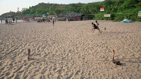 GOA, INDIA - MARCH 2013: boys playing beach footba Stock Video Footage