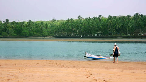 GOA, INDIA - MARCH 2013: Tourist Getting Boat Wate stock footage