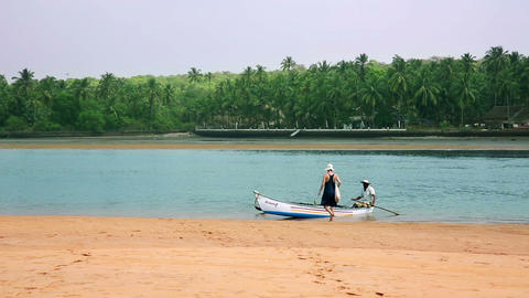 GOA, INDIA - MARCH 2013: tourist getting boat wate Stock Video Footage