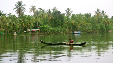 ALLEPPEY, INDIA - MARCH 2013: Man fishing on canal Stock Video Footage
