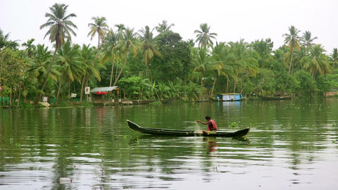 ALLEPPEY, INDIA - MARCH 2013: Man fishing on canal Footage
