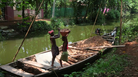 ALLEPPEY, INDIA - MARCH 2013: Boat moving along ca Stock Video Footage