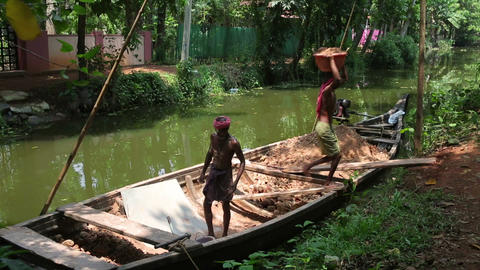 ALLEPPEY, INDIA - MARCH 2013: Boat moving along ca Footage