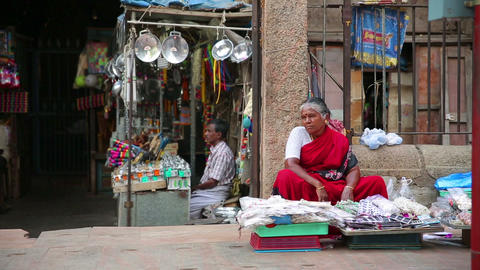 MADURAI, INDIA - MARCH 2013: Woman selling goods i Stock Video Footage