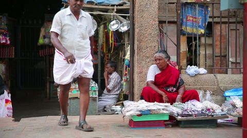 MADURAI, INDIA - MARCH 2013: Woman selling goods i Footage
