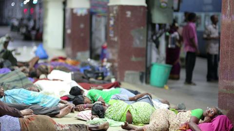 MADURAI, INDIA - MARCH 2013: People sleeping on ra Footage