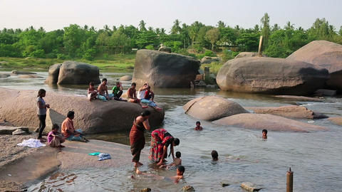 HAMPI, INDIA - APRIL 2013: People bathing in mount Footage