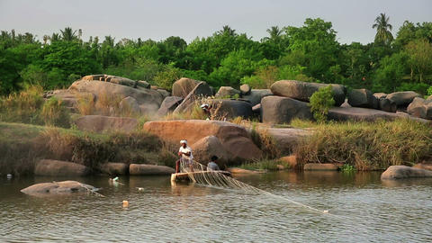 HAMPI, INDIA - APRIL 2013: Men fishing in mountain Footage