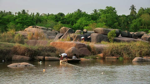 HAMPI, INDIA - APRIL 2013: Men fishing in mountain Stock Video Footage