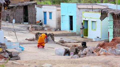 HAMPI, INDIA - APRIL 2013: Woman swiping street Stock Video Footage