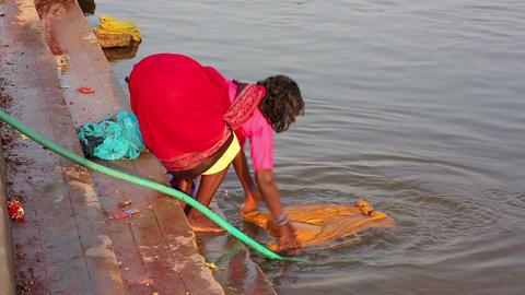 HAMPI, INDIA - APRIL 2013: Local women doing laund Stock Video Footage