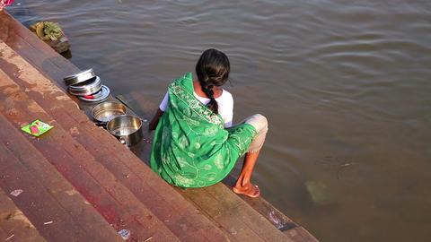 HAMPI, INDIA - APRIL 2013: Local woman washing dis Stock Video Footage