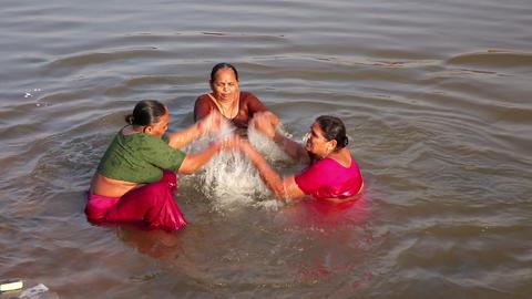 HAMPI, INDIA - APRIL 2013: Local women splashing i Footage