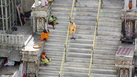 UDAIPUR, INDIA - APRIL, 2013: People sitting on st Stock Video Footage