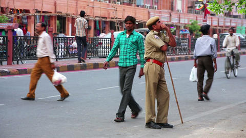 JAIPUR, INDIA - APRIL, 2013: Street traffic and po Stock Video Footage