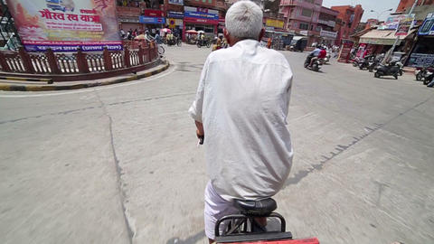 JAIPUR, INDIA - APRIL, 2013: Man riding rickshaw i Stock Video Footage