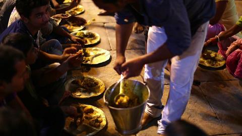 VARANASI, INDIA - MAY 2013: people eating free foo Footage