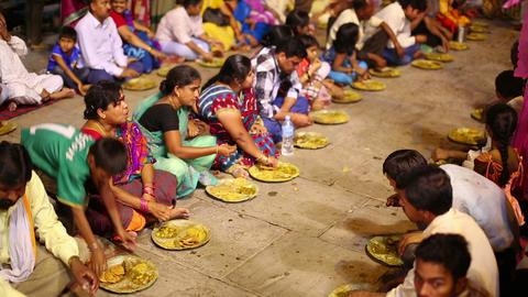 VARANASI, INDIA - MAY 2013: people eating free foo Stock Video Footage