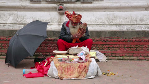 KATHMANDU, NEPAL - JUNE 2013: Senior man chanting  Footage