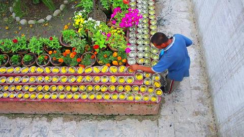 KATHMANDU, NEPAL - JUNE 2013: Man pouring water at Stock Video Footage