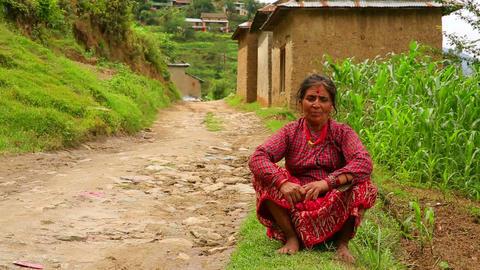 NAGARKOT, NEPAL - JUNE 2013: Nepali vilager at her Footage