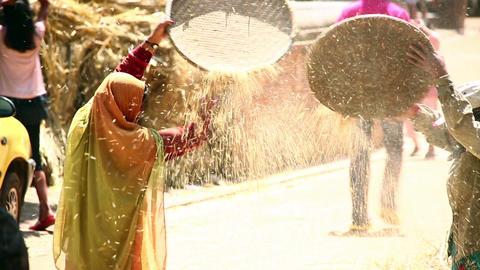 KATHMANDU, NEPAL - JUNE 2013: local woman sieving, Footage