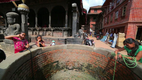 KATHMANDU, NEPAL - JUNE 2013: Pulling water contai Stock Video Footage