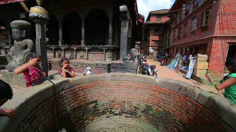 KATHMANDU, NEPAL - JUNE 2013: Pulling water contai Footage