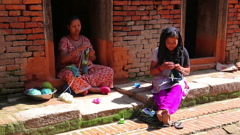 KATHMANDU, NEPAL - JUNE 2013: local women knitting Footage