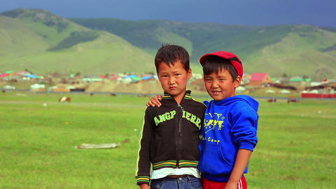 ULAANBAATAR, MONGOLIA - JULY 2013: Mongol kids pos Stock Video Footage
