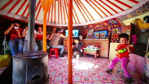 MONGOLIA - JULY 2013: Mongolian family inside yurt Stock Video Footage