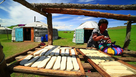 MONGOLIA - JULY 2013: Mongolian woman preparing fo Stock Video Footage