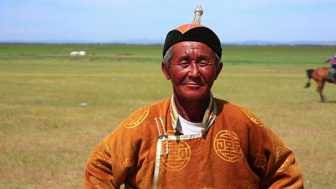 MONGOLIA - JULY 2013: Mongolian man with tradition Stock Video Footage
